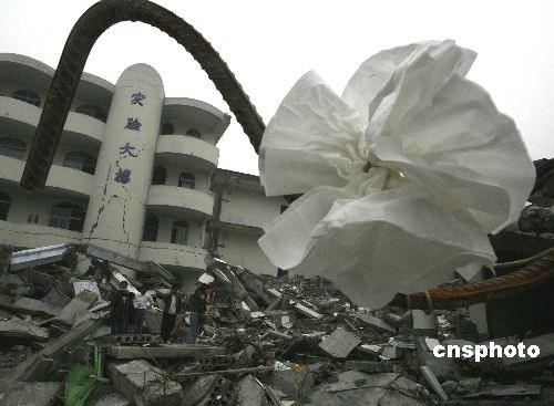 In this photo taken on May 17, 2008, the old Juyuan High School was reduced to rubble by the Sichuan earthquake on May 12, 2008. Among the 2,800 students at school that day, 278 died and 11 were missing.