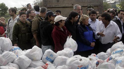 Chilean president tours quake zone