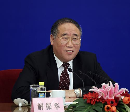 Xie Zhenhua, vice minister of the National Development and Reform Commission, answers questions at the press conference. [Xinhua]