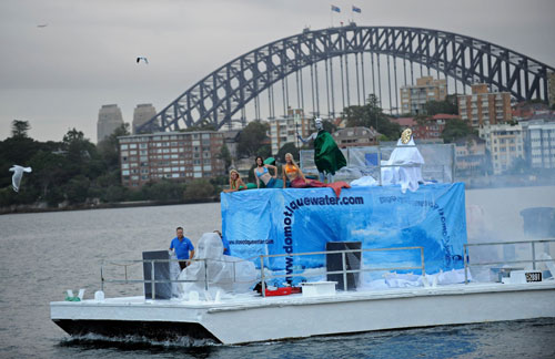 Marine biologists dress up as Mermainds and SeaGod and sit on a ship 'Iceberg' to mark World Water Day March 22, 2010, in Australia. This is the 18th World Water Day. UN-Water has chosen ''Clean Water for a Healthy World' as theme for World Water Day 2010. [Xinhua/AFP]