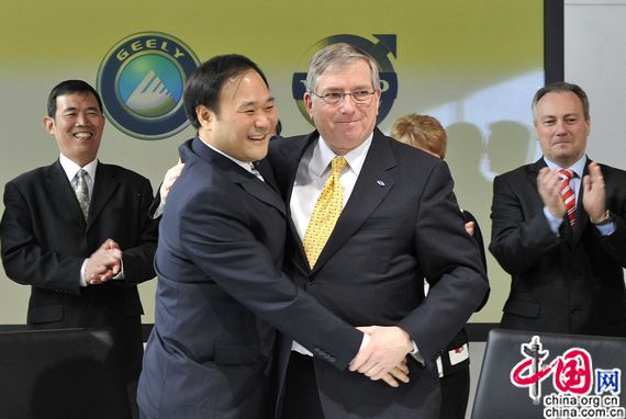 Geely's Chairman Li Shufu (L2) shakes hands with Ford's CFO Lewis Booth. China's Zhejiang Geely Holding Group on March 28 signs a deal with Ford Motor Co. on the takeover of Sweden's Volvo Cars.