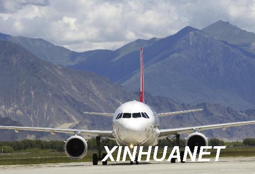 An undated photo shows a passenger plane             landing at the Lhasa Gonggar Airport. [Xinhua/Phurbu Tashi]