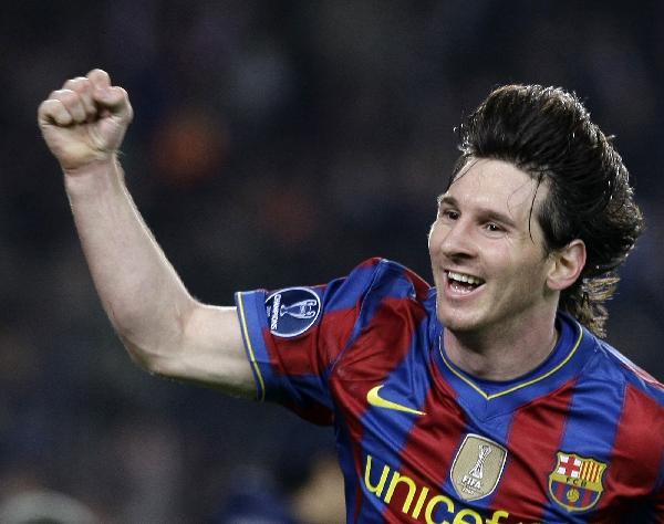 Barcelona's Lionel Messi of Argentina reacts after scoring a goal against Arsenal during their Champions League quarterfinal second leg soccer match at the Camp Nou Stadium in Barcelona, Spain, Tuesday, April 6, 2010. Messi scored four times as Barcelona beat Arsenal 4-1 to reach the Champions League semifinals for the third straight year. (Xinhua/Reuters Photo)