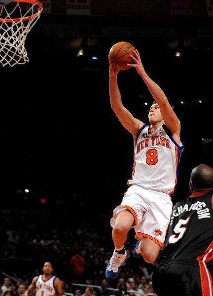 Danilo Gallinari (Top) of New York Knicks goes up for a shoot during their NBA basketball game against Miami Heat at Madison Square Garden in New York April 11, 2010. Heats won 111-98. (Xinhua/Shen Hong)(