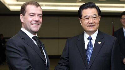 Hu, Medvedev pledge to boost bilateral relations