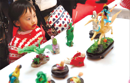 A child marvels at food made into various shapes at a
