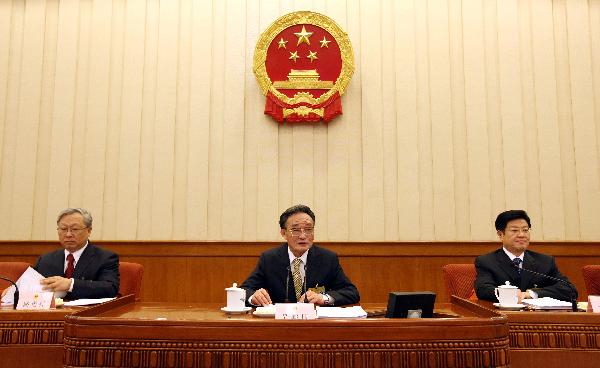 Wu Bangguo (C), chairman of the Standing Committee of the National People's Congress, China's top legislature, addresses the first plenary meeting of the 14th session of the Standing Committee of the 11th National People's Congress (NPC), in Beijing, capital of China, on April 26, 2010. [Xinhua]