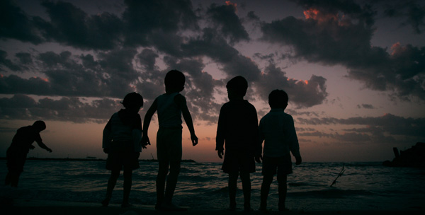 Palestinian boys enjoy the sunset on a beach in Gaza Strip, April 27, 2010. [Xinhua/Yasser Qudih]