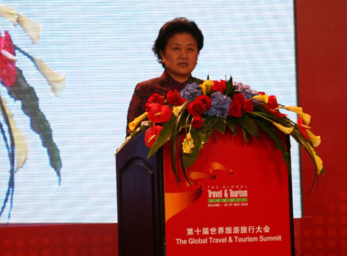 Chinese State Councilor Liu Yandong delivers a speech during the opening ceremony of the 10th Global Travel and Tourism Summit in Beijing on Tuesday, May 25, 2010. [Photo: CRIENGLISH]