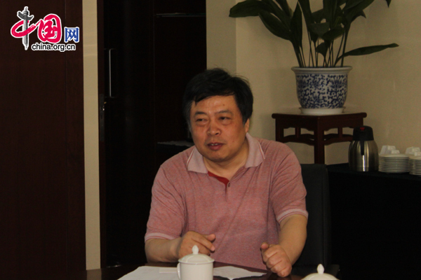 Xu Jiacheng, dean of the College of Vocational and Special Education at Beijing Union University, attends a planning meeting in Beijing, on May 27, 2010.