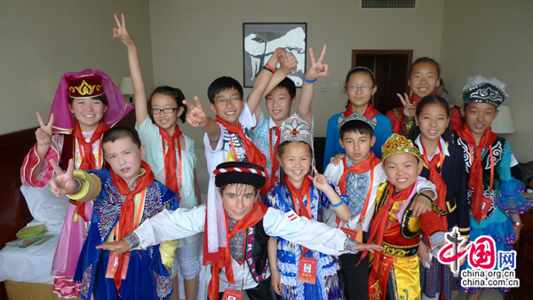 Thirteen young pioneer delegates from the Xinjiang Uygur Autonomous Region