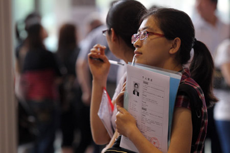 Applicants checking out employment opportunities at a recent job fair in Beijing.