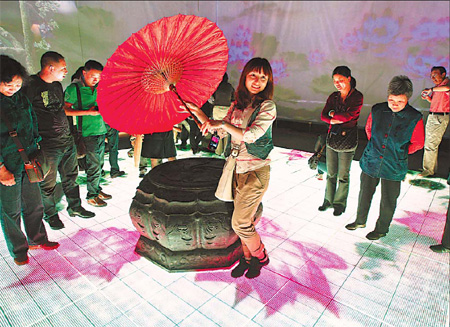 Tourists enjoy a light moment in the Anhui Pavilion at Expo 2010 Shanghai