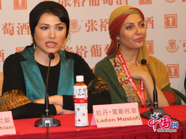 Iranian actress Ladan Mostofi (left) speaks at a press conference for the movie Pay Back that she stars in at Shanghai Film Art Center in Shanghai on June 16, 2010.