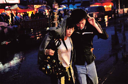 A young couple make their way home in Tangjialing. Many young urban couples live in the Beijing village.