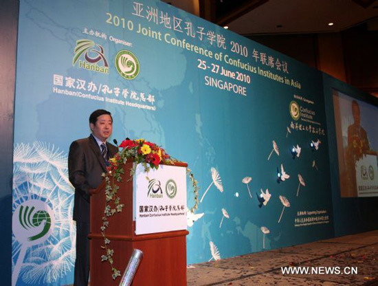 Wei Wei, Chinese ambassador to Singapore, delivers a speech at the 2010 Joint Conference of Confucius Institutes in Asia held in Singapore June 26, 2010.