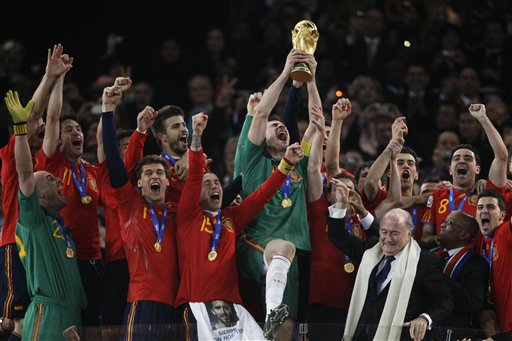 Spain goalkeeper Iker Casillas holds up the World Cup trophy after the World Cup final soccer match between the Netherlands and Spain at Soccer City in Johannesburg, South Africa, Sunday, July 11, 2010. Spain won 1-0.