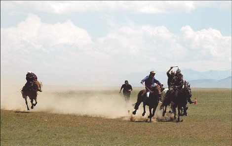 Local herdsmen showcase the prowess of their horses on the Bayanbulak grasslands in Xinjiang.