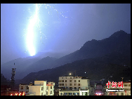 Flashes of lightning  is seen in Zhouqu County, Gansu Province on August 11, 2010.The National Meteorological Center warned on Aug. 11 of a significant chance of more landslides is threatening landslide-hit county Zhouqu in the coming days, with heavy rain of up to 90 millimeters expected to hit on Friday. [Chinanews.com]