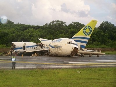 A Boeing 737 passenger jet crashed and broke into three pieces after landing during a storm on San Andres island in Colombia yesterday, but the only fatality was a passenger who died from a heart attack.