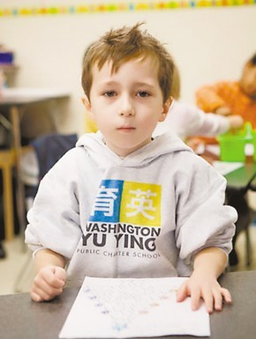 In this file photo an American boy studies Chinese. A growing number of American parents want their children to learn Mandarin and Chinese culture.