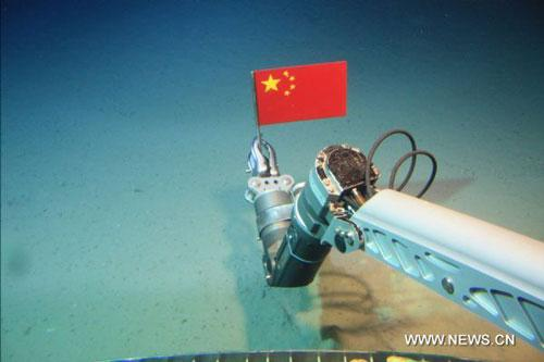 The file photo shows the submersible 'Jiaolong' catching a sample of deep sea's living beings during one dive in the South China Sea in July of 2010. [Xinhua]