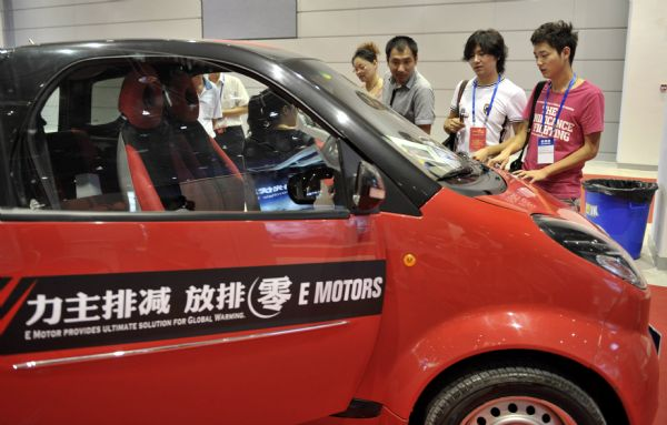 Visitors view electric cars at the 2nd China (Wuxi) Renewable Energy Conference and Solar Power Exhibition held in Wuxi City, east China's Jiangsu Province, Sept. 17, 2010. The 2nd China (Wuxi) Renewable Energy Conference and Solar Power Exhibition kicked off on Friday. Over 100 companies and institutes of renewable energy displayed advanced technology and products in the exhibition.