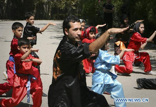 Masoud Jafari (C), vice president of Taiji Research Association of Confucius Institute at Tehran University, teaches his students martial arts at a park in Tehran, capital of Iran, on Sept. 24, 2010. This Confucius Institute was officially opened in Tehran, on Jan. 12, 2009. It is the first Confucius Institute in Iran.