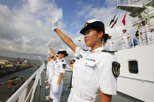 Crew members of China's hospital ship Peace Ark waves goodbye on the deck before the ship's departure at the port of Djibouti, Sept. 29, 2010. The Peace Ark left for Kenya on Wednesday after providing medical services for local residents in Djibouti for a week. [Xinhua photo]