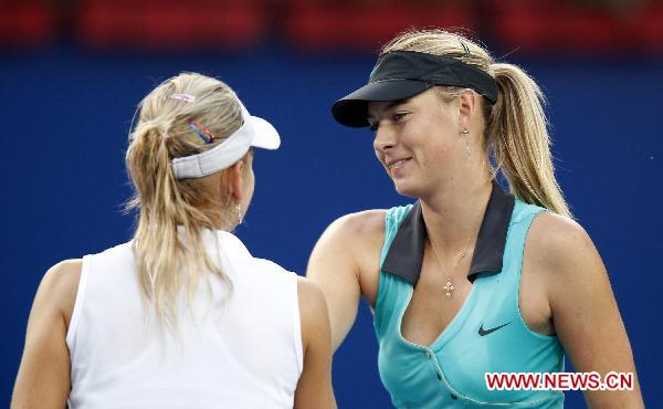 Maria Sharapova (R) of Russia greets her compatriot Elena Vesnina after their second round match of women's singles in 2010 China Tennis Open Tournament in Beijing, China, Oct. 5, 2010. Sharapova lost 0-2. [Xinhua/Wang Lili]