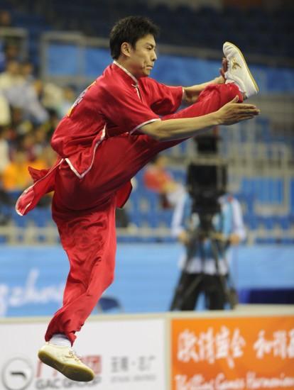 Yuan Xiaochao of China won the first gold medal of the Guangzhou Asian Games in the men's Changquan Wushu event on Saturday. [Xinhua]