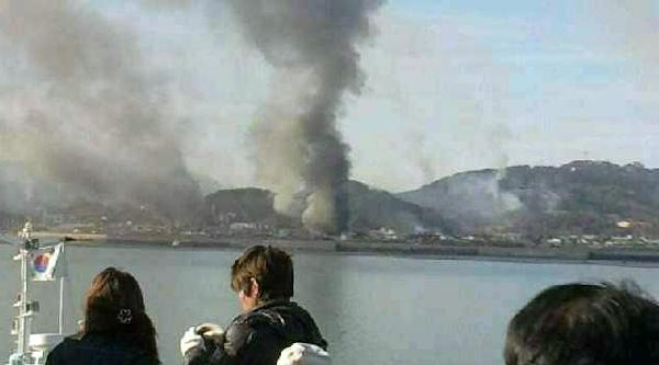 Smoke is seen at Yeonpyeong island near the border against the Democratic People's Republic of Korea (DPRK), in South Korea, Tuesday, Nov. 23, 2010. [Xinhua]