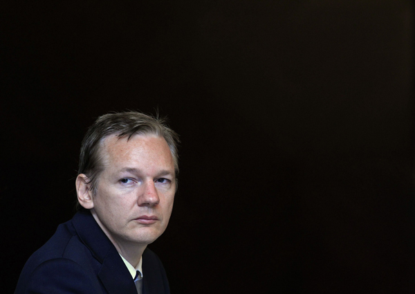 Wikileaks founder Julian Assange listens during a news conference on the internet release of secret documents about the Iraq War, in London October 23, 2010. [Xinhua]