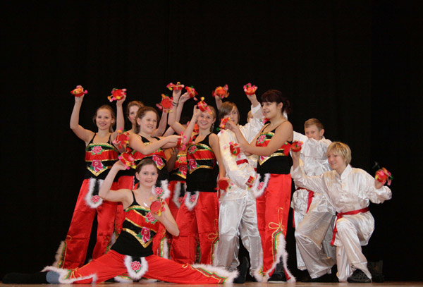 Students from the 6th to 9th grades of Niels Steensens Gymnasium perform Chinese folk dance 'Yanhe Wu', in Copenhagen, capital of Denmark, on Nov. 25, 2010, during the inauguration ceremony of Gymnasium's new Confucius Class. The establishment ceremony of Denmark's second Confucius class was held on Thursday in Copenhagen. [Devapriyo Das/Xinhua]