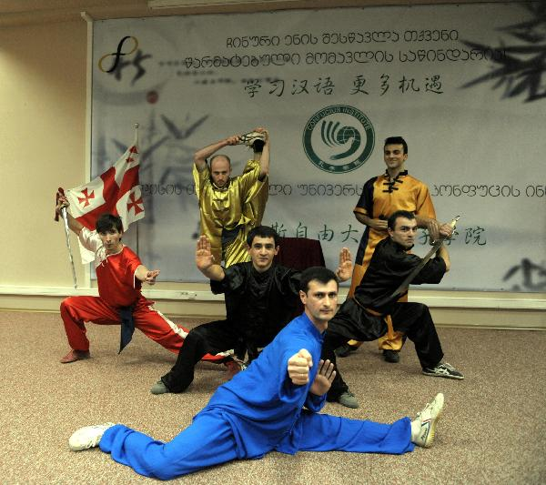 Students perform Chinese martial arts during the inauguration ceremony of the Confucius Institute at the Free University of Tbilisi in Tbilisi, Georgia, Nov. 26, 2010. The Confucius Institute is jointly established by Free University of Tbilisi and China's Lanzhou University based on the Chinese language department of the Free University of Tbilisi. [Liu Lihang/Xinhua]