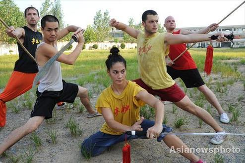 Overseas university students learn Shaolin kung fu at a kung fu school on Songshan Mountain of Central China's Henan province on August 4, 2010.
