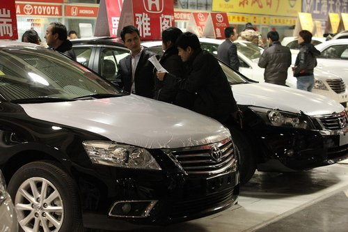 More than 20,000 cars were sold in Beijing in the first week of December as citizens scrambled to buy vehicles ahead of curbs aimed at reducing the city's massive traffic jams.