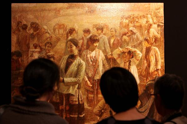 People look at Chinese artists' paintings during the Salon 2010 held by the French National Society of Fine Arts at Carrousel in the Louvre Palace in Paris, capital of France, Dec. 16, 2010. The 4-day salon opened here on Thursday. 51 Chinese artists participated in the salon with their 53 pieces of artworks.