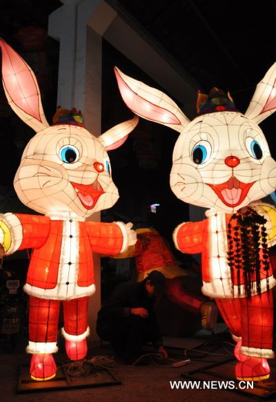 A craftsman adjusts the illumination of rabbit-shaped lanterns in a lantern factory in Suzhou, east China's Jiangsu Province, Jan. 23, 2011. The Chinese Lunary New Year began on Feb. 3 this year and it will be the year of the rabbit, one of the twelve Chinese zodiac animals.