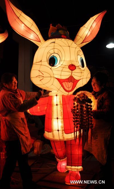 Craftswomen display rabbit-shaped lanterns in a lantern factory in Suzhou, east China's Jiangsu Province, Jan. 23, 2011. The Chinese Lunary New Year began on Feb. 3 this year and it will be the year of the rabbit, one of the twelve Chinese zodiac animals.
