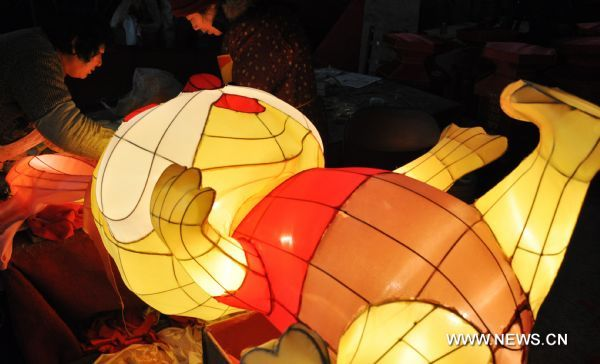 Craftswomen decorate a rabbit-shaped lantern in a lantern factory in Suzhou, east China's Jiangsu Province, Jan. 23, 2011. The Chinese Lunary New Year began on Feb. 3 this year and it will be the year of the rabbit, one of the twelve Chinese zodiac animals.