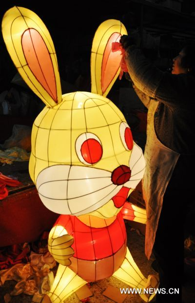 A craftswoman decorates a rabbit-shaped lantern in a lantern factory in Suzhou, east China's Jiangsu Province, Jan. 23, 2011. The Chinese Lunary New Year began on Feb. 3 this year and it will be the year of the rabbit, one of the twelve Chinese zodiac animals.