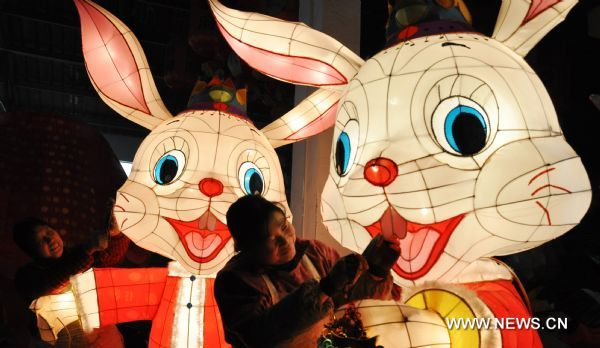 Craftswomen trim rabbit-shaped lanterns in a lantern factory in Suzhou, east China's Jiangsu Province, Jan. 23, 2011. The Chinese Lunary New Year began on Feb. 3 this year and it will be the year of the rabbit, one of the twelve Chinese zodiac animals.
