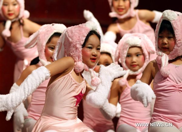 Children perform a rabbit dance during a celebration marking the upcoming Chinese Lunar Year of the Rabbit, in Toronto, Canada, Jan. 22, 2011.