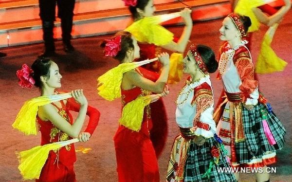 Chinese and Russian dancers perform in Heihe, northeast China's Heilongjiang Province, Jan. 24, 2011, to greet the upcoming Chinese Spring Festival which falls on Feb. 3 this year. 