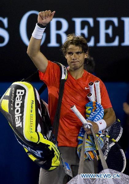 Rafael Nadal of Spain waves to the audience after losing the men's singles quarterfinal against his compatriot David Ferrer at the Australian Open tennis tournament in Melbourne, Australia, on Jan. 26, 2011. Nadal failed to qualify for the semifinal after losing the match 0-3. (Xinhua/Chen Duo)