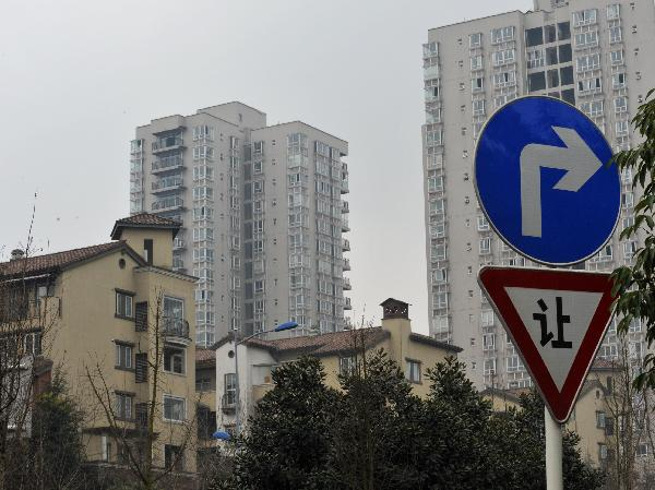 Photo taken on Jan. 21, 2011 shows a high-class residential area in southwest China's Chongqing Municipality. The State Council, China's cabinet, has approved on a trial basis the launch of property tax reforms in some cities. Shanghai and Chongqing are cities that will trial the tax first. Chongqing sets its property tax rate at 0.5 to 1.2 percent. [Xinhua]