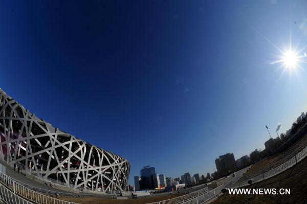 Photo taken on Jan. 29, 2011 shows the National Stadium, also known as the 'Bird's Nest' in the sun in Beijing, capital of China. Beijing breaked a 60-year record for the latest date for its first snowfall of the season on Saturday. Since 1951, the latest record of the first snowfall in Beijing was in 1984, when it arrived on Jan. 29. (Xinhua/Gong Lei) (ly) 