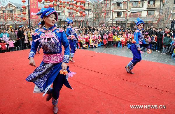 Local residents perform to celebrate the coming new year in Yingxiu Town of Wenchuan County, southwest China's Sichuan Province, Jan. 31, 2011. [Chen Kai/Xinhua]