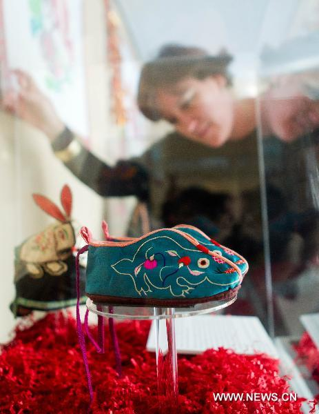 A visitor looks at the rabbit-shaped shoes during an exhibition at the Bata Shoe Museum in Toronto, Canada, Feb. 8, 2011. A 40-day-long exhibition featuring rabbit-shaped Chinese shoes is on show at the Bata Shoe Museum to celebrate the Chinese Lunar New Year, the year of Rabbit.